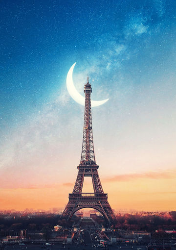 Eiffeltower-at-night-with-big-eclipse-moon.jpg